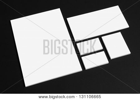 Blank stationery branding mockup on black with letter and business cards.