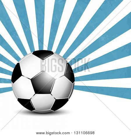 Soccer ball against blue starburst background