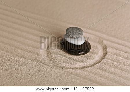 Zen garden with stones on sand background