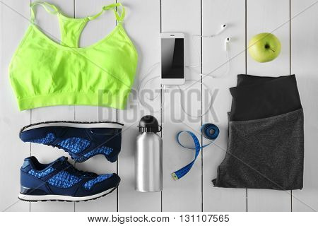 Female sport equipment on a white background
