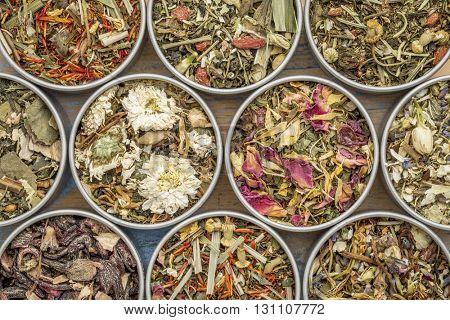 collection of ten herbal blend Chinese tea in round metal cans, top view