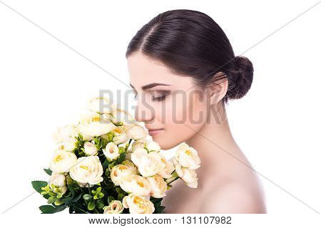 Side View Of Young Beautiful Woman With Flowers Isolated On White