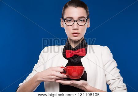 Portrait Of A Girl With Red Cup In His Hands