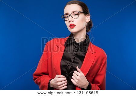 Portrait Of A Girl With Glasses And A Red Jacket