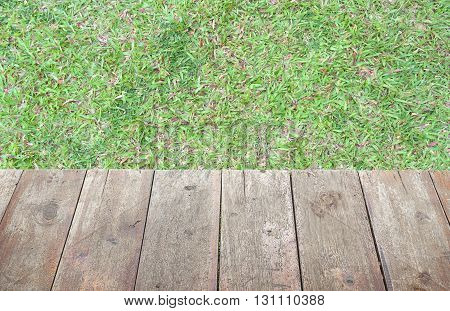 grass and old wooden floor and space for add text above