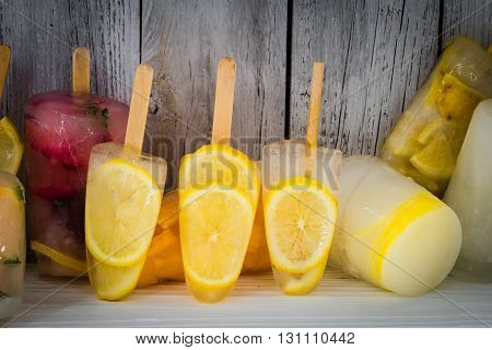 different ice-cream fruit frozen fruits on wooden background