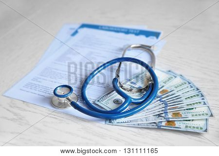 Stethoscope and medical forms on white wooden background. Healthcare concept