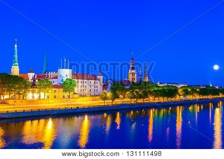 Old Town Of Riga With Reflection In Daugava River At Night, Riga Castle, Riga Cathedral, Saint Peter