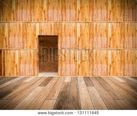 Wooden Wall With Door And Wood Floor In Front Off