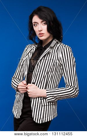 girl in black and white jacket on a blue background