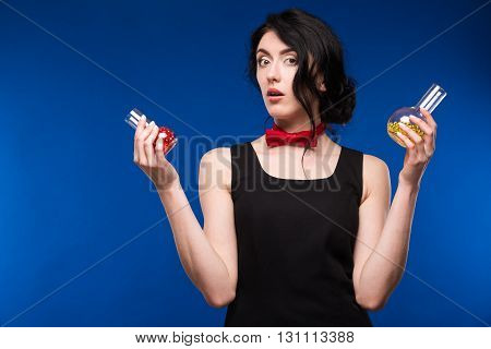 girl with a test tube and pills