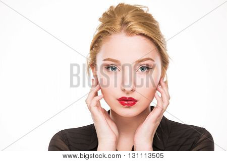 Girl in a black shirt with makeup on a background