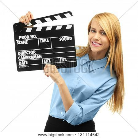 Young attractive woman holding film clapper isolated on white