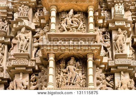 Sculptured surface of famous indian temple of Khajuraho with Hindu gods. UNESCO Heritage site built between 950 and 1150 in India belong to two different religions - Hinduism and Jainism.