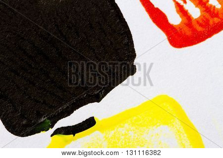 Abstract hand painted red black and yellow acrylic art background