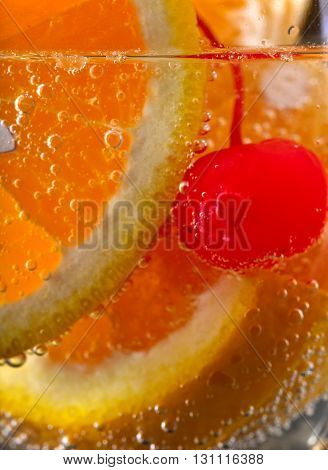 Drink With Orange And Sweet Cherry