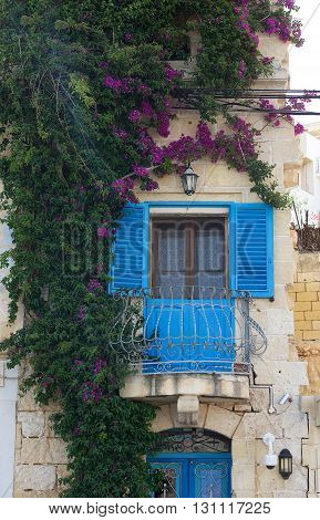 Old typical maltese house decorated with flowers