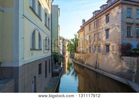 view of the narrow channel among houses in Prague