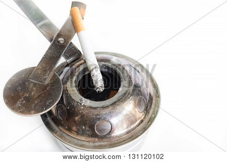 cigarette and ashtray. Some man like smoking in work time for make idea. Isolated on white background(select focus cigarettes)