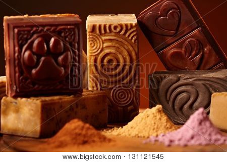 Variety of natural hand made soap bars and ingredients.