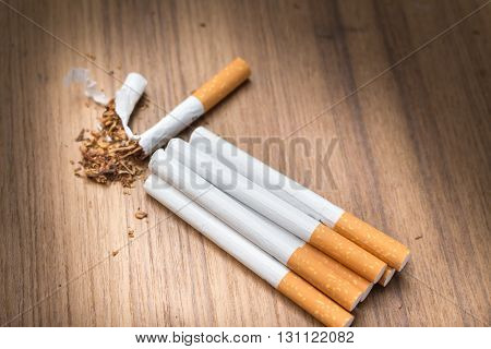 stop smoking Tobacco tear cigarette detrimental on wood background and space for add text above select focus front cigarette (Open light cigarettes)
