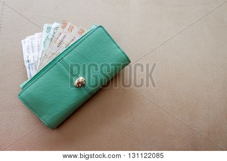 Money notes in purse on a ground