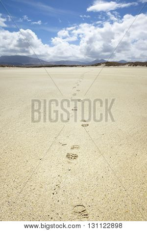 An image of a beautiful sand beach with footprints at Donegal Ireland