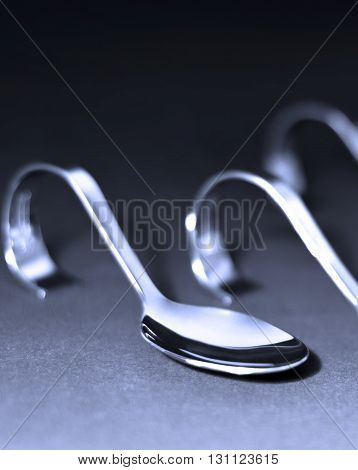Silver spoons. Stack of elegant silver spoons, isolated on black.