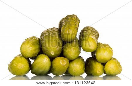 Many pickled cucumbers isolated on white background.