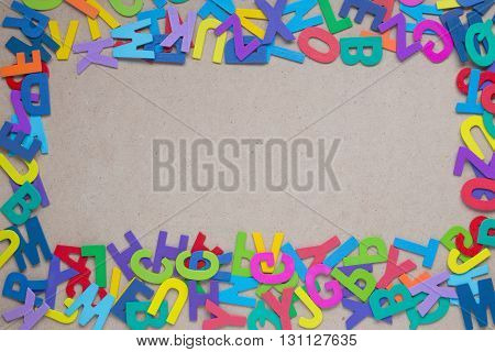 Random wooden colorful alphabets on wood with empty copy space in the center