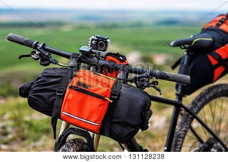 Mountain Bicycle outdoor with orange bags for travel