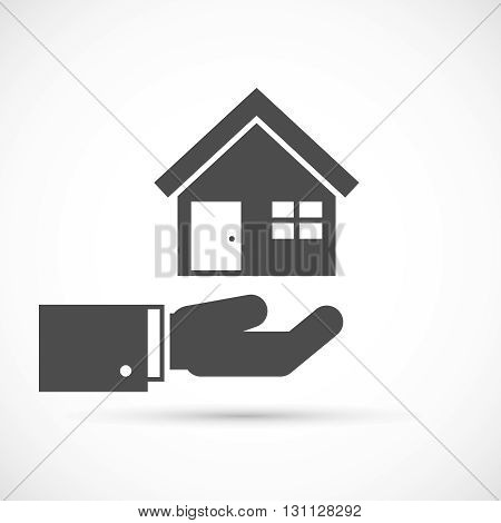 Holding house on hand. Home on the hand icon