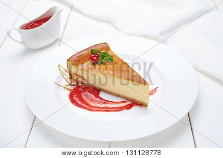 Cheesecake traditional cheese cake sweet pastry dessert with berry sauce in white plate