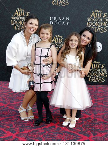 Kyle Richards and Ali Landry at the Los Angeles premiere of 'Alice Through The Looking Glass' held at the El Capitan Theater in Hollywood, USA on May 23, 2016.