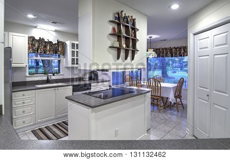 Simple white dated kitchen with island