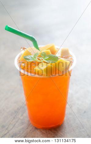 iced mango tea lemonade on wooden background