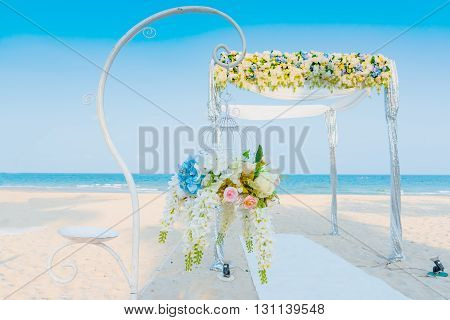 Flower Bouquet Hanging For Decoration On The Walkway Of  Wedding Ceremony On The Beach