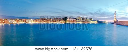 Scenic panoramic view of the old harbor with the lighthouse in Chania during twilight. Crete, Greece.