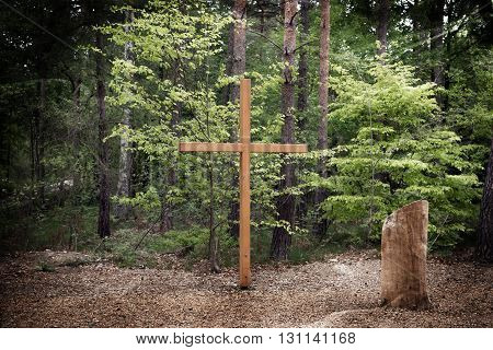 Wooden cross in the forest, nature Cemetery