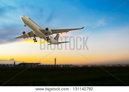 Commercial airplane take off at beautiful sunset