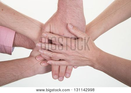 Business Team Making Pile Of Hands At Meeting