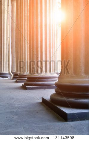 Colonnade of the Kazan Cathedral in Saint-Petersburg Russia with sunlight breaking through the columns. Soft focus processing