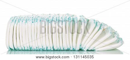 A stack of children's diapers isolated on white background.