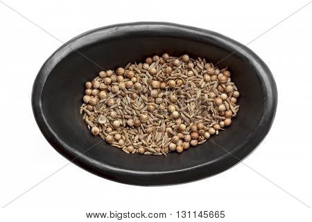 Cumin and coriander seeds in rustic black bowl, isolated on white.  Overhead view.
