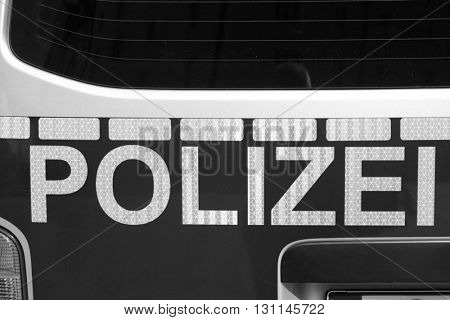 Back of german police car. Black and white image