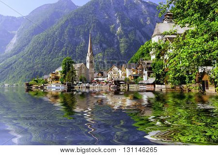 village at foot of mountains on lake shore