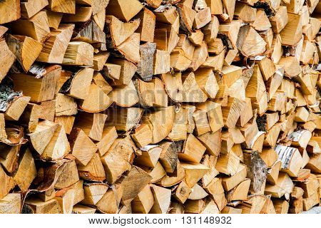 Pile of wood logs as background, texture