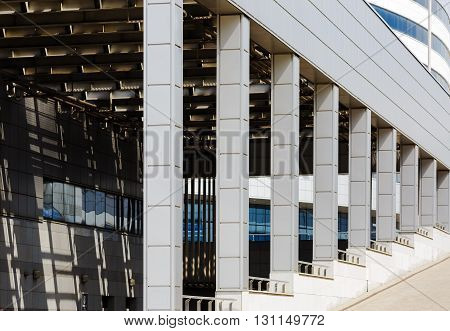 Close-up of modern industrial architecture. Modern industrial building with a colonnade.