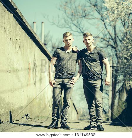 Twin Brothers Pose Outdoor