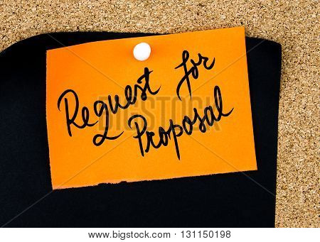 Request For Proposal Written On Orange Paper Note